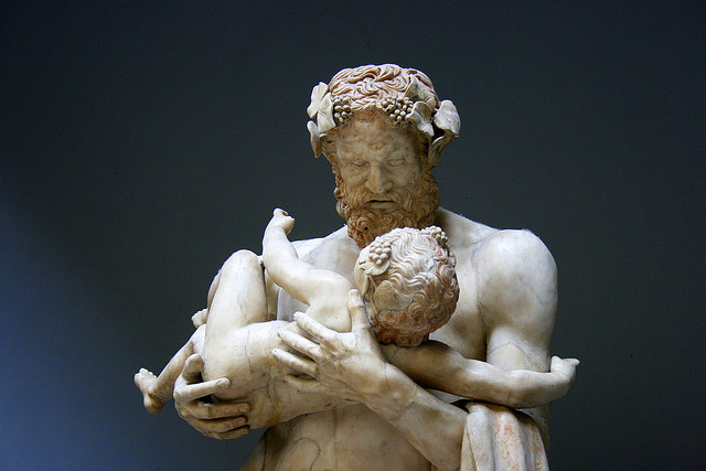 A statue of Silenus with the young God Dionysus on his arm.